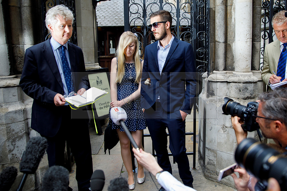 © Licensed to London News Pictures. 10/07/2017. London, UK. CONNIE YATES and CHRIS GARD give a statement at The High Court in London on 10 July 2017. The parents of terminally ill Charlie Gard have returned to the High Court in light of new evidence relating to potential treatment for their son's condition. An earlier lengthy legal battle ruled that Charlie could not be taken to the US for experimental treatment. London, UK. Photo credit: Tolga Akmen/LNP