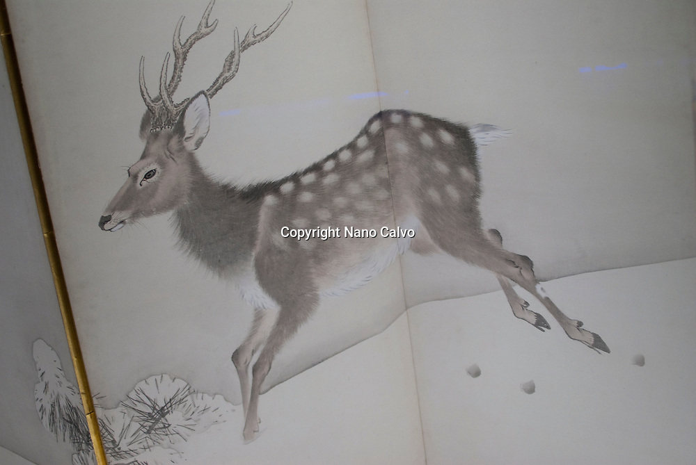 """Morikawa Sobun, Deer and Pine in the Snow, a pair of 6-fold screen paintings. Japan, Meiji era, around AD 1892..""""Treasures of the world's cultures"""" is an exhibition organised by the Community of Madrid and the Canal de Isabel II at the Arte Canal Exhibition Centre. With over 280 pieces, covering all parts of the globe and different historic periods, its the first time that this exhibition, created by the British Museum in London, has been organised in Europe and it has travelled to Spain, after a tour of several countries with great public acclaim."""