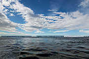 pristine beauty of the clean sky, water, and icebergs of Antarctica..