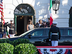 October 18, 2016 - Washington, DC, United States - on the South Lawn  of the White House in Washington, D.C., U.S., on Tuesday, Oct. 18, 2016., First Lady Michelle Obama, and President Barack Obama, await the arrival of Prime Minister Matteo Renzi and Mrs. Agnese Landini of Italy for an Official State Visit. This was the last Official State Visit for the Obama administration. (Credit Image: © Cheriss May/NurPhoto via ZUMA Press)