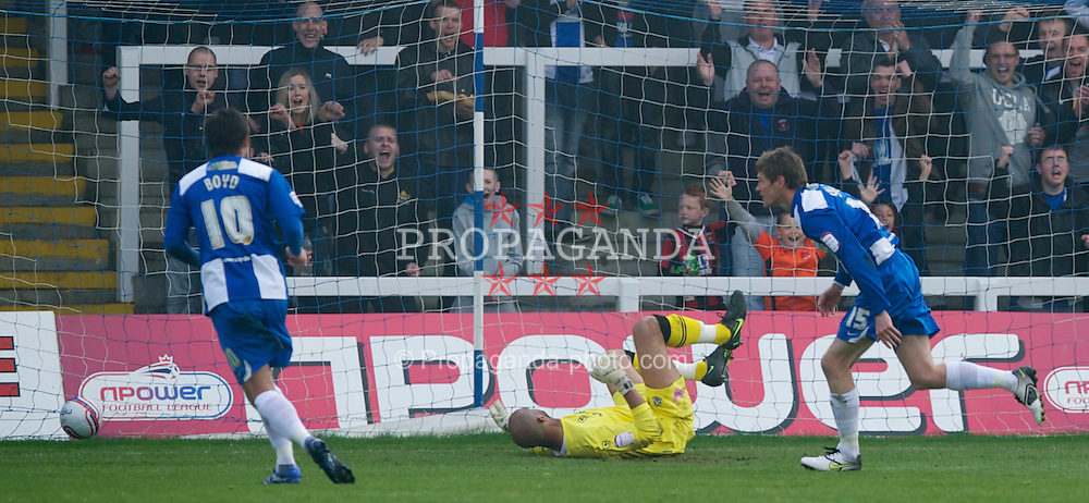 HARTLEPOOL, ENGLAND - Friday, April 22, 2011: Tranmere Rovers' goalkeeper Tony Warner is beaten by Hartlepool United's Antony Sweeney for the opening goal during the Football League One match at Victoria Park. (Photo by David Rawcliffe/Propaganda)