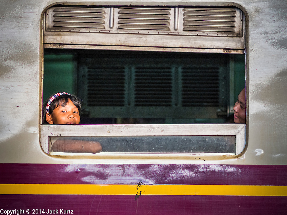 22 OCTOBER 2014 - BANGKOK, THAILAND: Children on a train wait for the train to leave Hua Lamphong Train station in Bangkok.      PHOTO BY JACK KURTZ