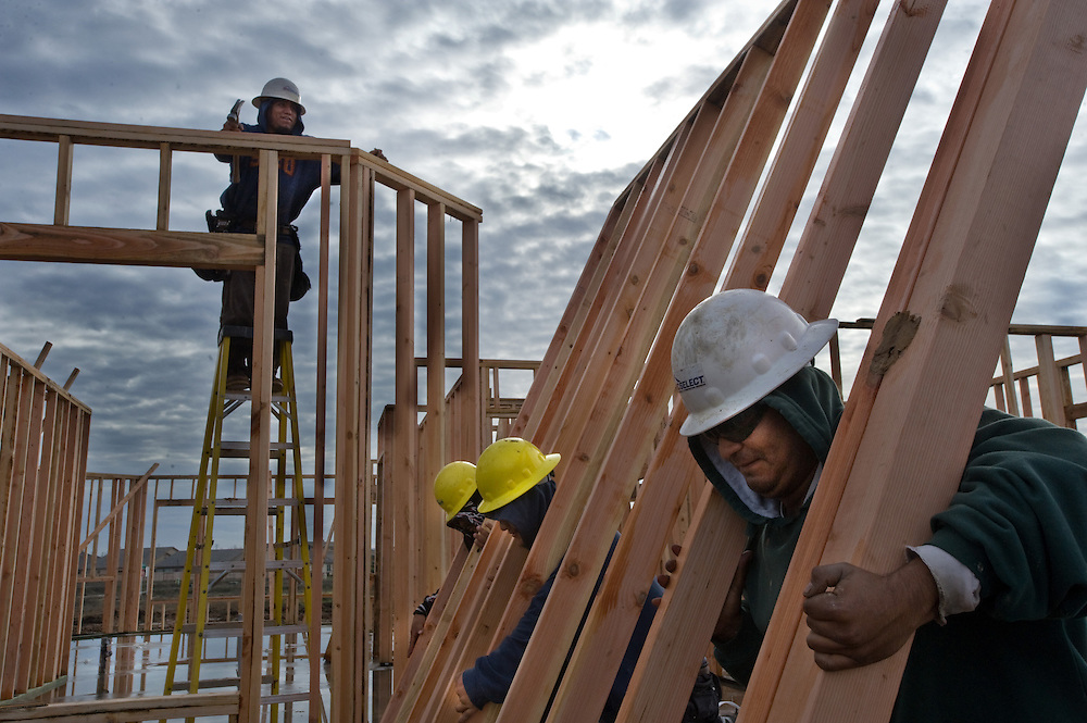 Construction workers put up a wall on a Pulte home. Feeling a little more confident about the economy, Pulte is putting up new homes in the Haddington section of the West Park development in Roseville, which is just west of Sun City Roseville.