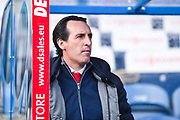Unai Emery of Arsenal (Manager) watches the warm up from the dug out before the Premier League match between Huddersfield Town and Arsenal at the John Smiths Stadium, Huddersfield, England on 9 February 2019.