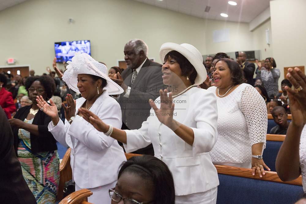 Worshippers join in during Rev. Al Sharpton address to a healing service at Charity Missionary Baptist Church April 12, 2015 in North Charleston, South Carolina. Sharpton spoke following the recent fatal shooting of unarmed motorist Walter Scott police and thanked the Mayor and Police Chief for doing the right thing in charging the officer with murder.