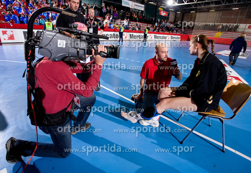 Injured Ana Gros interviewed by RTV Slovenija at handball match of Round 3 of Champions League between RK Krim Mercator and Hypo Niederosterreich, on November 8, 2009, in Arena Kodeljevo, Ljubljana, Slovenia.  Krim won 35:24. (Photo by Vid Ponikvar / Sportida)