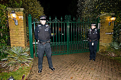 © London News Pictures. 06/12/2012. Walton-on-Thames, UK .  Police outside the home of Publicist Max Clifford in Walton on Thames, Surrey, UK after he was arrested in connection with the Jimmy Savile investigation. Photo credit: Ben Cawthra/LNP