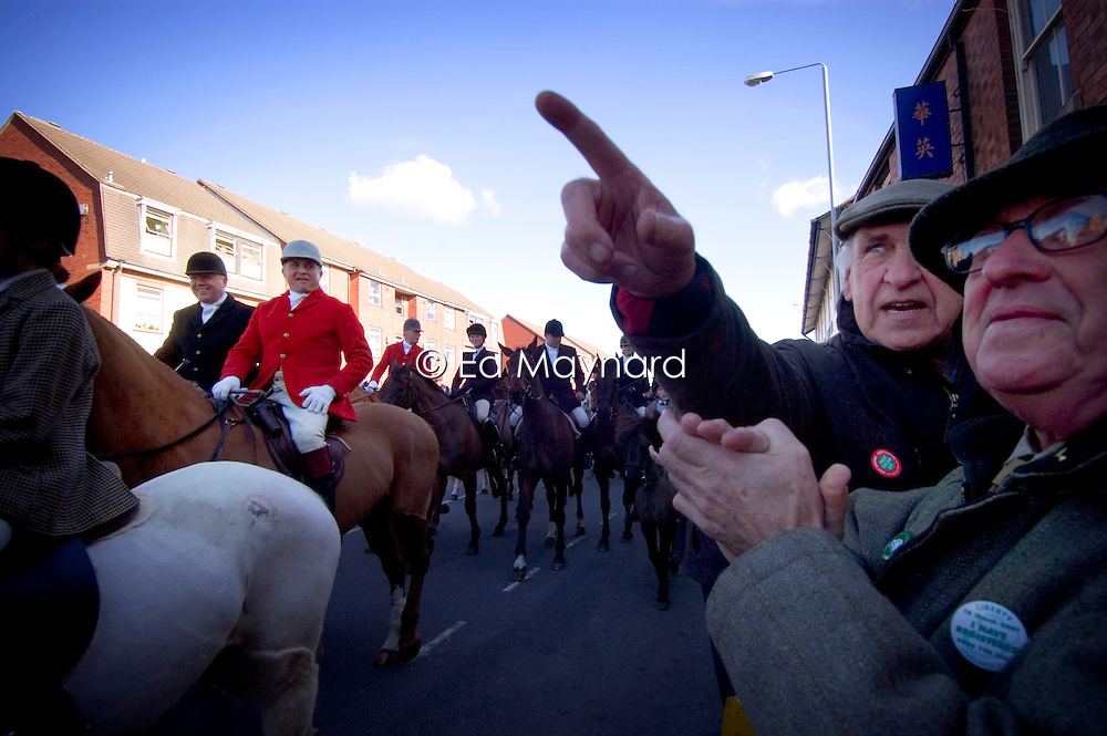 Hunt supporters watch as riders demonstrate through the town after the introduction of the hunting ban, Melton Mowbray, Leicestershire, England, United Kingdom.
