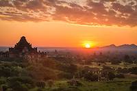 Sunrise over the plains of Bagan with view of the Dhammayan Gyi Temple on the left.