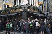 People drinking outside Dog and Duck pub, Bateman Street, Frith Street corner, London, England