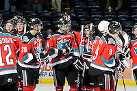 KELOWNA, CANADA, OCTOBER 26:  Affiliate player Austin Glover #26 of the Kelowna Rockets is congratulated after a win as the Prince George Cougars visit the Kelowna Rockets  on October 26, 2011 at Prospera Place in Kelowna, British Columbia, Canada (Photo by Marissa Baecker/Shoot the Breeze) *** Local Caption ***Austin Glover;