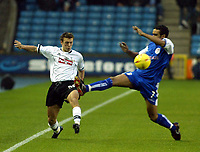 Photo. Chris Ratcliffe<br />Millwall v Derby County. FA Nationwide 1st Division. 22/11/2003<br />Lee Holmes of Derby and Paul ifill battle for the ball