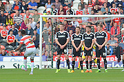 Cedric Evina  of Doncaster Rovers takes free kick during the Sky Bet League 1 match between Doncaster Rovers and Barnsley at the Keepmoat Stadium, Doncaster, England on 3 October 2015. Photo by Ian Lyall.