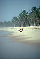 Man washing on the beach in Ghana