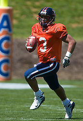 Virginia quarterback Riko Smalls (3) rushes out of the pocket during the spring game.  The Virginia Cavaliers football team played the annual spring football scrimmage at Scott Stadium on the Grounds of the University of Virginia in Charlottesville, VA on April 18, 2009.  (Special to the Daily Progress / Jason O. Watson)