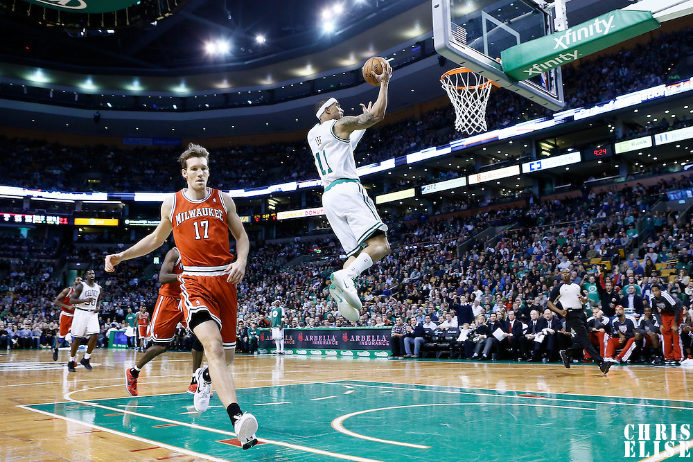 21 December 2012: Boston Celtics shooting guard Courtney Lee (11) goes for the layup on a fast break past Milwaukee Bucks small forward Mike Dunleavy (17) during the Milwaukee Bucks 99-94 overtime victory over the Boston Celtics at the TD Garden, Boston, Massachusetts, USA.