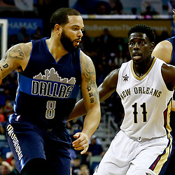 Dec 26, 2016; New Orleans, LA, USA;  Dallas Mavericks guard Deron Williams (8) drives past New Orleans Pelicans guard Jrue Holiday (11) during the first quarter of a game at the Smoothie King Center. Mandatory Credit: Derick E. Hingle-USA TODAY Sports