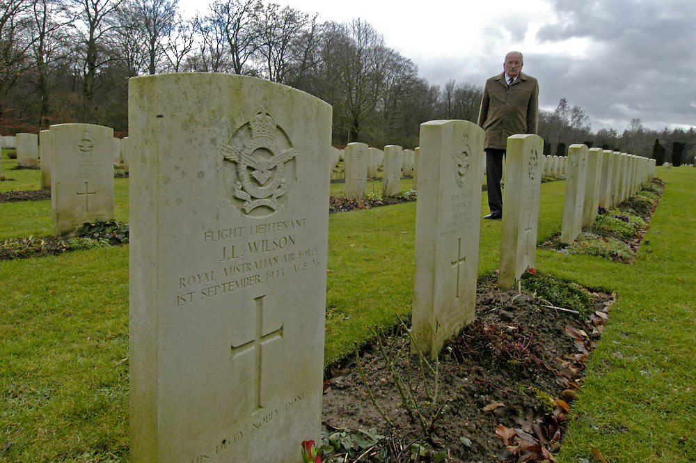 James Hopkins, Halifax Flight Engineer on his return visit to Germany. The headstones of James's former crew member in the Reichwald cemetery, Kleve, Germany.