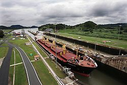 "A ship passes through the Miraflores Lock in the Panama Canal as seen from the Miraflores Visitor Center Observation Deck.  Panama is poised to become the ""next Costa Rica"", though tourists have yet to begin flocking to the central american country.  The Capital, Panama City, is home to the Panama Canal and, due to the former US military presence, is one of the continents capitals most comfortable for people from the United States.  The country offers a variety of eco-tourism opportunities as well as a capital that mixes a modern feel with a colonial center."