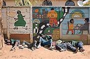 Children that live on the streets of Harare, Zimbabwe sleep in the yard of the Streets Ahead centre under a Mural about living on the streets. The children often sleep for some of the time, as it's a nice safe environment. Streets Ahead is a welfare organisation that works with underprivileged children living on the streets of Harare.
