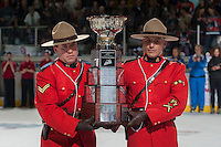 KELOWNA, CANADA - MAY 13: The RCMP carry the WHL Championship trophy onto the ice on May 13, 2015 during game 4 of the WHL final series at Prospera Place in Kelowna, British Columbia, Canada.  (Photo by Marissa Baecker/Shoot the Breeze)  *** Local Caption ***