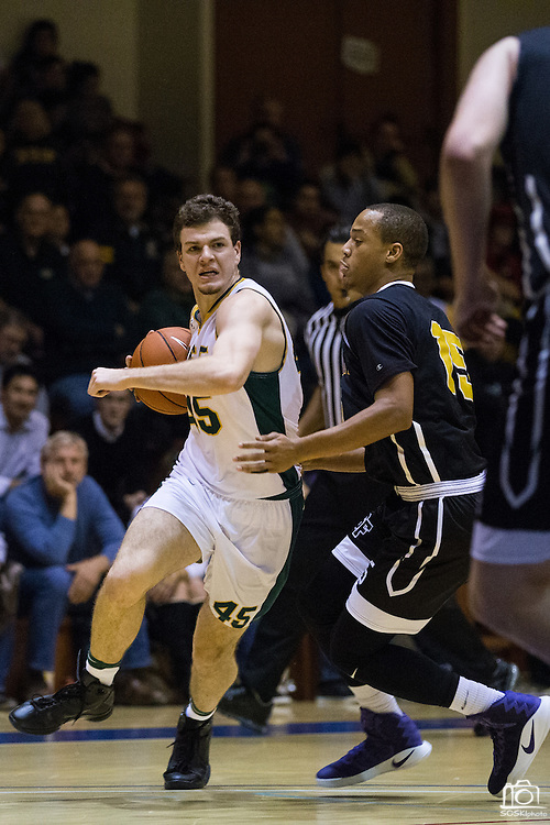 San Francisco Dons guard Mladen Djordjevic (45) attacks the basket against the San Francisco State University Gators at Kezar Pavilion in San Francisco, Calif., on December 6, 2016. (Stan Olszewski/Special to S.F. Examiner)