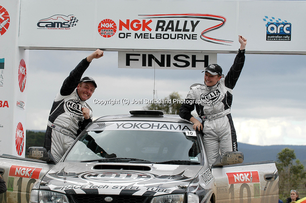 Simon & Sue Evans celebrate first ever round win.Motorsport-Rally.2003 NGK Rally of Melbourne.Yarra Valley, Victoria .5th of October 2003 .(C) Joel Strickland Photographics