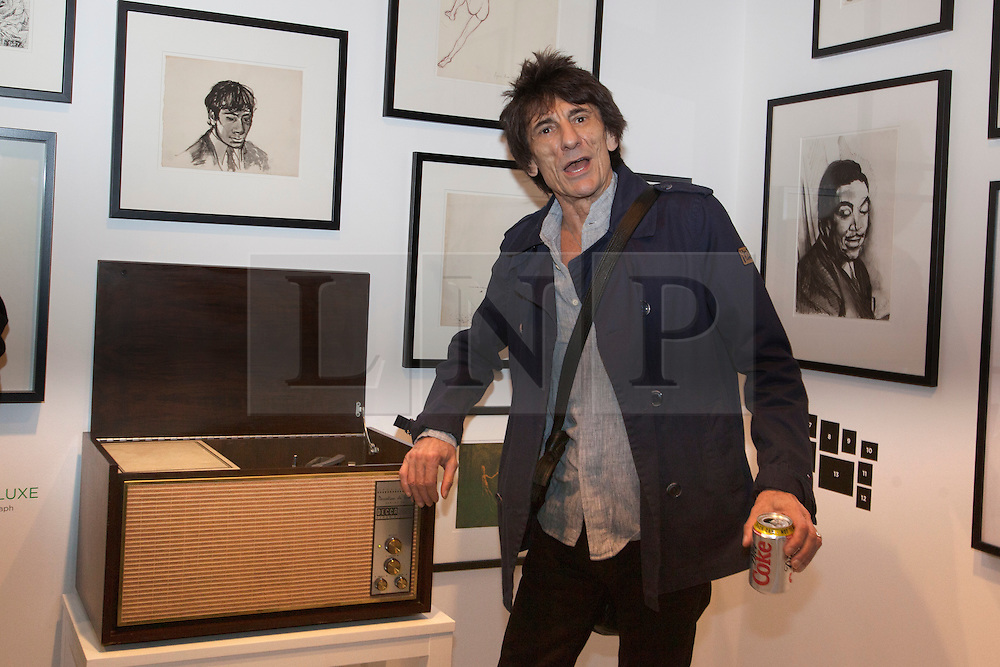 © licensed to London News Pictures. London, UK 13/08/2012. Ronnie Wood posing next to his old phonograph at the 'A Major Retrospective Of 50 Years Of Rock And Roll' exhibition in central London.  Photo credit: Tolga Akmen/LNP