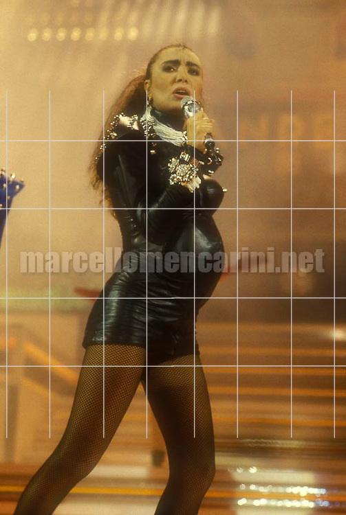 "Sanremo Music Festival 1986. Italian pop singer Loredana Bertè performing her song ""Re"" with a fake belly as a pregnant woman / Festival di Sanremo 1986. Loredana Bertè canta ""Re"" con una pancia finta da donna incinta - © Marcello Mencarini"