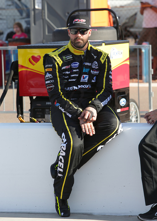 Paul Menard before qualifying for Sunday's NASCAR Cup Series auto race on Friday, March 17, 2017, in Avondale, Ariz.  (AP Photo/Rick Scuteri)