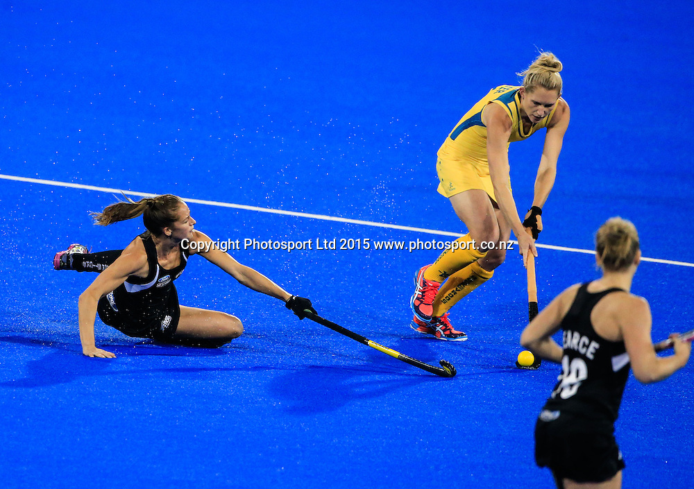 Australia's Kirstin Dwyer steps through a sliding tackle by Petrea Webster. New Zealand Black Sticks Women v Australia, Final, Festival of Hockey, Unison Hockey Stadium, Hastings, New Zealand. Sunday, 19 April, 2015. Copyright photo: John Cowpland / www.photosport.co.nz