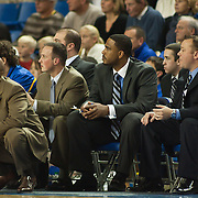 12/03/11 Newark DE: Delaware Men's head coach Monté Ross (Left) and his staff watches the play develop in front their bench during a Colonial Athletic Association conference basketball game, Saturday, Dec. 03, 2011 at the Bob carpenter center in Newark Delaware...Sophomore Guard #10 Devon Saddler would finish the game with 30 total points, Delaware defeat Drexel 71-60.