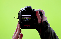 MANCHESTER, ENGLAND - Wednesday, March 16, 2016: A photographer shoots a 'Hail Mary' as he tries to get a general view shot of Liverpool players during a training session at Old Trafford ahead of the UEFA Europa League Round of 16 2nd Leg match against Manchester United. (Pic by David Rawcliffe/Propaganda)