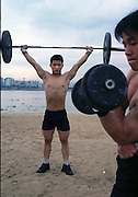 Shi Lung town Sports Academy for Weightlifters, .Xie Xianwen 17, (l) and Wang Wulin 16 (r) training by the river.