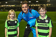 Forest Green Rovers Elliott Frear(11) with the mascots during the Vanarama National League match between Forest Green Rovers and Tranmere Rovers at the New Lawn, Forest Green, United Kingdom on 22 November 2016. Photo by Shane Healey.