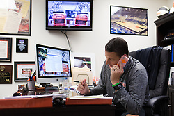 UPike Men's head basketball coach Kelly Wells talks on the phone during office hours, Wednesday, Sept. 24, 2014 at the Eastern Kentucky Expo Center in Pikeville. Photo by Jonathan Palmer, Special to the CJ