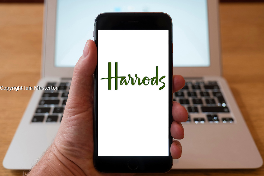 Using iPhone smartphone to display logo of Harrods department store