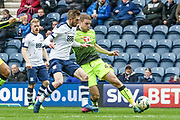 Tom Barkhuizen challenges Reading Defender Joey van den Berg during the EFL Sky Bet Championship match between Preston North End and Reading at Deepdale, Preston, England on 11 March 2017. Photo by Pete Burns.