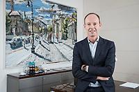 27 MAR 2018, BERLIN/GERMANY:<br /> Thomas Rabe, Vorstandsvorsitzender Bertelsmann SE &amp; Co. KGaA, in seinem Buero, vor einem Bild seines Freundes Christopher Lehmpfuhl (Rabe sagt, es kann verwendet werden) aus seiner Serie &quot;Berlin&quot;, Bertelsmann Repraesentanz Berlin ,Unter den Linden<br /> IMAGE: 20180327-01-001<br /> KEYWORDS: B&uuml;ro