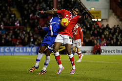 Jay Emmanuel-Thomas of Bristol City is challenged by Gavin Hoyte of Gillingham - Photo mandatory by-line: Rogan Thomson/JMP - 07966 386802 - 29/01/2015 - SPORT - FOOTBALL - Bristol, England - Ashton Gate Stadium - Bristol City v Gillingham - Johnstone's Paint Trophy Southern Area Final Second Leg.