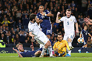 Georgy Dzhikiya of Russia (14) (Zenit St Petersburg)clears as Scotland forward Matt Phillips (19) (West Bromwich Albion) tries to finish in the goalmouth scramble  during the UEFA European 2020 Qualifier match between Scotland and Russia at Hampden Park, Glasgow, United Kingdom on 6 September 2019.