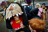 """Caid Wood, 9, walks along Sherman Avenue in his """"Wild Thing"""" costume while listening to his classmate talk about how much candy he received during Sorensen Magnet School's Halloween parade Friday."""