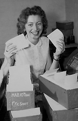 File photo dated 31/05/57 of Pam Grewer, 21, at the Premium Savings Bonds office in Lytham St Annes, Lancashire, as she checks through some of the bonds that will go into tomorrow's first Premium Savings Bonds draw. Premium Bonds are celebrating 60 years since the first draw on June 1 1957.