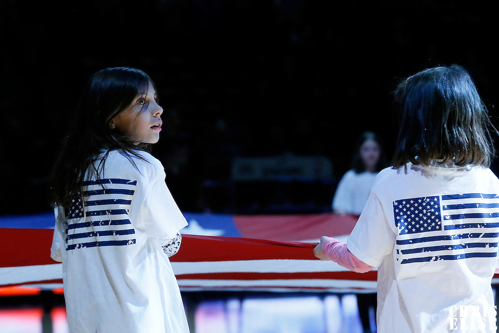 04 March 2016: A young girl is seen holding the flag during the national anthem sang prior to the Brooklyn Nets 121-120 victory over the Denver Nuggets, at the Pepsi Center, Denver, Colorado, USA.