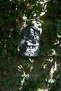 Buddha icon on garden fence at the Rivendell Buddhist Retreat Centre, East Sussex, England.
