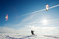 JEROME A. POLLOS/Press..Scott Owbridge is pulled on his snowboard Wednesday, Dec. 6, 2006 by a large kite typically used for kite boarding on rivers and lakes. Owbridge and his friend Tony Hall took advantage of the light wind and clear, blue skies to carve a few turns on the Rathdrum Prairie.