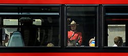 © Licensed to London News Pictures. 23/05/2012. London, UK Constable Davis Tsui seen in position through traffic on Whitehall. Canadian Mounties Guard Her Majesty the Queen at Horse Guards Parade on Whitehall in Westminster. They will guard on all day and will be the first non-British force to guard the Queen. Photo credit : Stephen Simpson/LNP