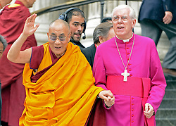 © Licensed to London News Pictures. 14/05/2012. City of London, UK The Dalai Lama (L) meets The Right Reverend Michael Colclough as he arrives at St Paul's Cathedral today 14 may 2012 to be presented with the £1.1m Templeton annual prize in his first visit to the Cathedral. The award is for a living person who has 'made an exceptional contribution to affirming the spiritual dimension of life'.. Photo credit : Stephen Simpson/LNP