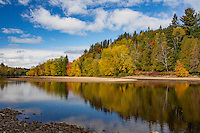 Autumn reflections on the Riviere Rouge in the Municipality of Labelle, Quebec. © Allen McEachern.