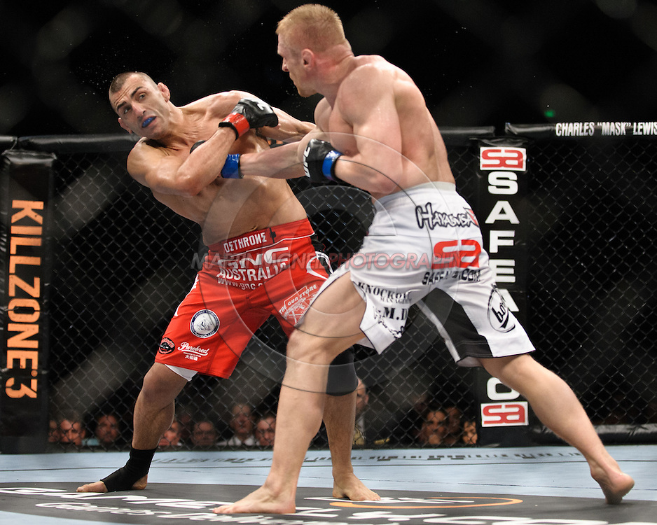 """SYDNEY, AUSTRALIA, FEBRUARY 27, 2011: George Sotiropoulos (left) evades a punch from Dennis Siver during """"UFC 127: Penn vs. Fitch"""" inside Acer Arena in Sydney, Australia on February 27, 2011."""